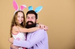 Spring holiday. Easter spirit. Easter activities for whole family. Happy easter. Holiday bunny long ears. Family. Tradition concept. Dad and daughter wear bunny stock images