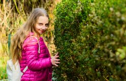 Spring holiday. Green environment. little girl spend free time in park. Natural beauty. Childhood happiness. happy child royalty free stock photography