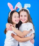 Spring holiday. Happy childhood. Friendship concept. Easter vibes. Happy easter. Holiday bunny girls with long bunny. Ears hug. Children easter bunny costume stock images