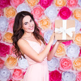 Spring and holidays concept - happy young beautiful woman with g Stock Photos