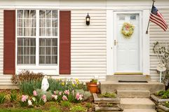 Spring home landscaping. A view of early spring flowers and gardening in the front yard of a townhouse royalty free stock images
