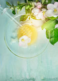 Spring honey on glass plate with dipper and fresh blossom on light blue rustic wooden background, top view Stock Photo