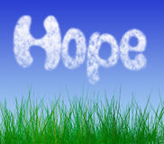 Spring hope. HOPE written in clouds on a beautiful spring sky Royalty Free Stock Images