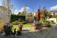 Spring house back yard with red chairs Royalty Free Stock Image