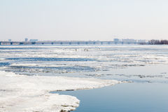 The spring ice drift on the river Volga. Road bridge in the city of Saratov. Russia. A Sunny day in March. Blue sky Stock Image