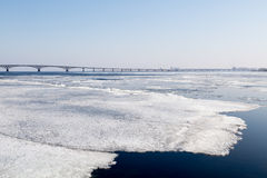 The spring ice drift on the river Volga. Road bridge in the city of Saratov. Russia. A Sunny day in March. Blue sky Stock Photography