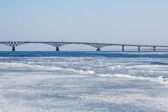 The spring ice drift on the river Volga. Road bridge in the city of Saratov. Russia. A Sunny day in March. Blue sky Royalty Free Stock Image