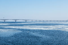 The spring ice drift on the river Volga. Road bridge in the city of Saratov. Russia. A Sunny day in March. Blue sky Royalty Free Stock Images