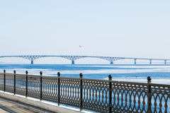 The spring ice drift on the river Volga. Road bridge in the city of Saratov. Russia. A Sunny day in March. Blue sky Stock Photos