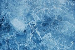 Spring ice of a frozen Creek in the forest, the texture of the i. Ce Royalty Free Stock Photo