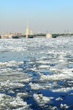 Spring icedrift on the Neva river and Peter and Paul fortress on the background Royalty Free Stock Image