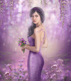 Spring Illustration beautiful Fantasy woman with purple flowers in sakura background Stock Photo