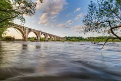 Spring on the James River. May train bridge Richmond Virginia green water flowing stock photography