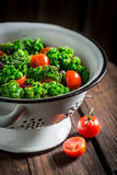 Spring kale salad with green peas and cherry tomatoes Stock Images