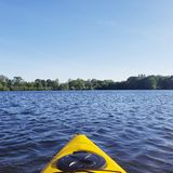 Spring Kayaking on a Peaceful Lake royalty free stock photography