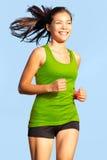Spring - kvinna som går för en körning Royaltyfri Bild