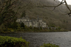 Spring at Kylemore. Kylemore Abbey in Connemara, Co Galway, Ireland.  Windy spring day creating calm waves in the lake Royalty Free Stock Image