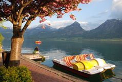 Spring at lake. Two pedal boats on lake wolfgangsee, austria stock photos