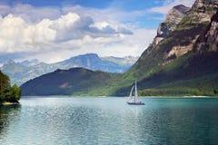 Spring lake scene. Mountain view in the Klontalersee, Switzerland Stock Photos