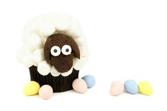 Spring lamb cupcake with candy eggs Stock Images