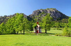 Spring landcape with mountain and chapel Stock Images