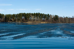 Spring landscape. Remains of thawing ice on a Vuoksi river, Russia Royalty Free Stock Photos