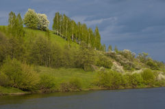 Spring landscape against  thunder-cloud background Stock Photography