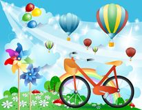 Spring landscape with bike, pinwheels and balloons Royalty Free Stock Image