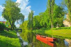 Spring landscape with boat on the Narew river. Royalty Free Stock Photos
