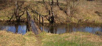 Spring landscape bridge over a small stream Stock Image