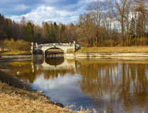 Spring landscape with a bridge on the sunny day. Royalty Free Stock Image