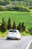 Spring landscape, car driving fast on country road Stock Images