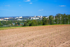 Spring landscape with  city and the opened field Stock Images