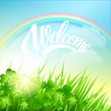 Spring landscape with clover and rainbow Stock Images