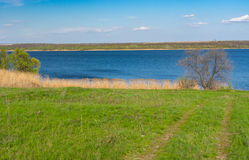Spring landscape with an earth road leading to Dniepr river Royalty Free Stock Photography