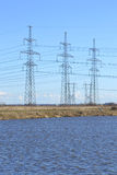 Spring landscape with electricity pylons Royalty Free Stock Image