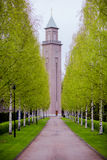 Spring landscape in Finland, Helsinki. Alley with birch trees and a chapel for a walking Stock Photos