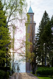 Spring landscape in Finland, Helsinki. Alley with birch trees and a chapel for a walking Royalty Free Stock Image