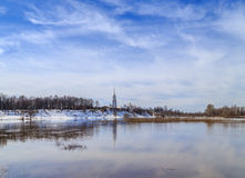 Spring landscape, flood on the river. Spring landscape, high water on the river, blue sky, snow on the banks of the remains Royalty Free Stock Photos