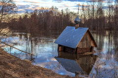 Spring landscape, flooded chapel. River, evening Royalty Free Stock Photos