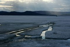 Spring landscape with ice drift on the lake stock photography