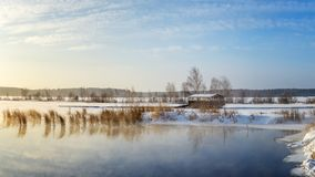 Spring landscape at lake with reeds and a gazebo Russia, the Urals royalty free stock photography