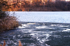 Spring landscape with melting ice on the lake on a clear day Stock Photo