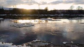 Spring landscape with moving ice floes. And clouds, 4k timelapse footage stock footage