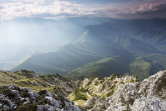 Spring landscape and Piatra Craiului mountains in background,Tra Royalty Free Stock Images