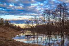 Spring landscape, pour a river flood. Ed trees and chapel Stock Image