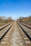 Spring landscape with railway under blue sky Stock Image
