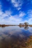 Spring landscape, river, blue sky. Light clouds, april Royalty Free Stock Images