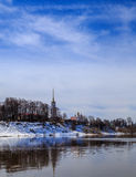 Spring landscape, the river flooded, the banks still snow. Blue sky with light clouds Stock Photography