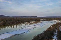 Spring landscape with river and ice. Spring landscape with river and clouds, forestand ice Stock Image